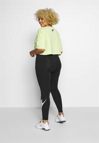 Nike Sportswear - LEGASEE PLUS - Leggings - black/white - 2