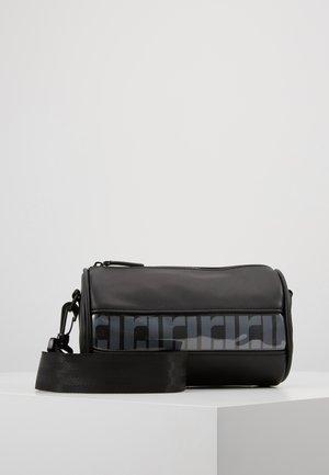 RI MONO PVC BARREL - Weekend bag - black