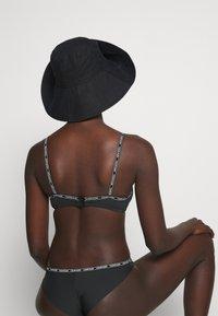 Calvin Klein Swimwear - CORE LOGO TAPE BRALETTE - Bikini top - black - 3