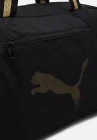 Puma - GRIP BAG 25 L - Sportovní taška - black/bright gold - 5