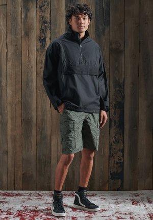 Shorts - olive grid camo