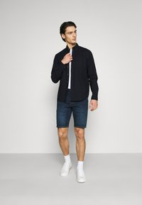 Levi's® - 502™ TAPER SHORTS - Denim shorts - dark indigo - 1