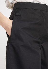 Didriksons - MALVINA WOMEN'S PANTS - Outdoor trousers - black - 4
