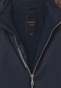 Name it - NMNSNOW UNISEX - Snowsuit - dark sapphire - 4