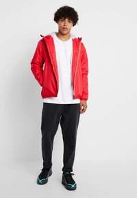 K-Way - UNISEX CLAUDE ORESETTO - Light jacket - red - 1