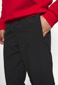 adidas Originals - SLICE TREFOIL ADICOLOR PRIMEGREEN ORIGINALS SLIM TRACK - Tracksuit bottoms - black/blue oxide - 4