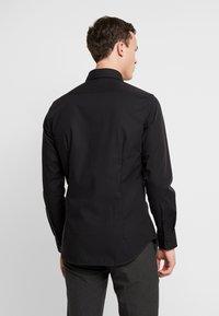 Seidensticker - SLIM FIT - Formal shirt - black - 2