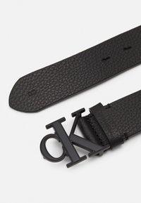 Calvin Klein Jeans - LOGO TEXT  - Belt - black - 1