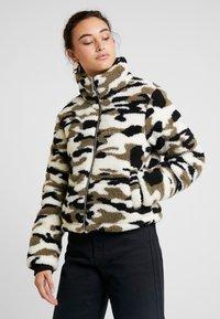 Urban Classics - LADIES CAMO SHERPA JACKET - Winter jacket - wood - 0