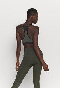 Ellesse - GRIZA - Medium support sports bra - black - 2