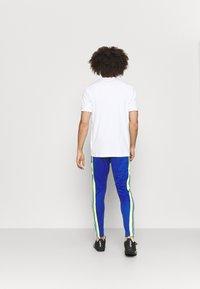 adidas Performance - SQUAD - Tracksuit bottoms - team royal blue/team solar yellow - 2
