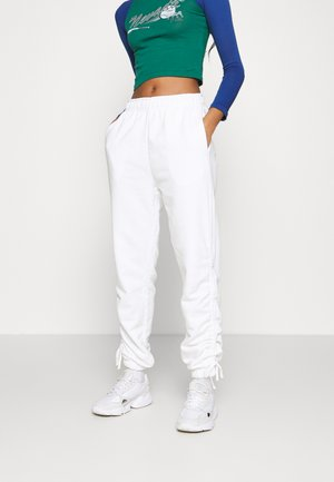 RUCHED - Tracksuit bottoms - white