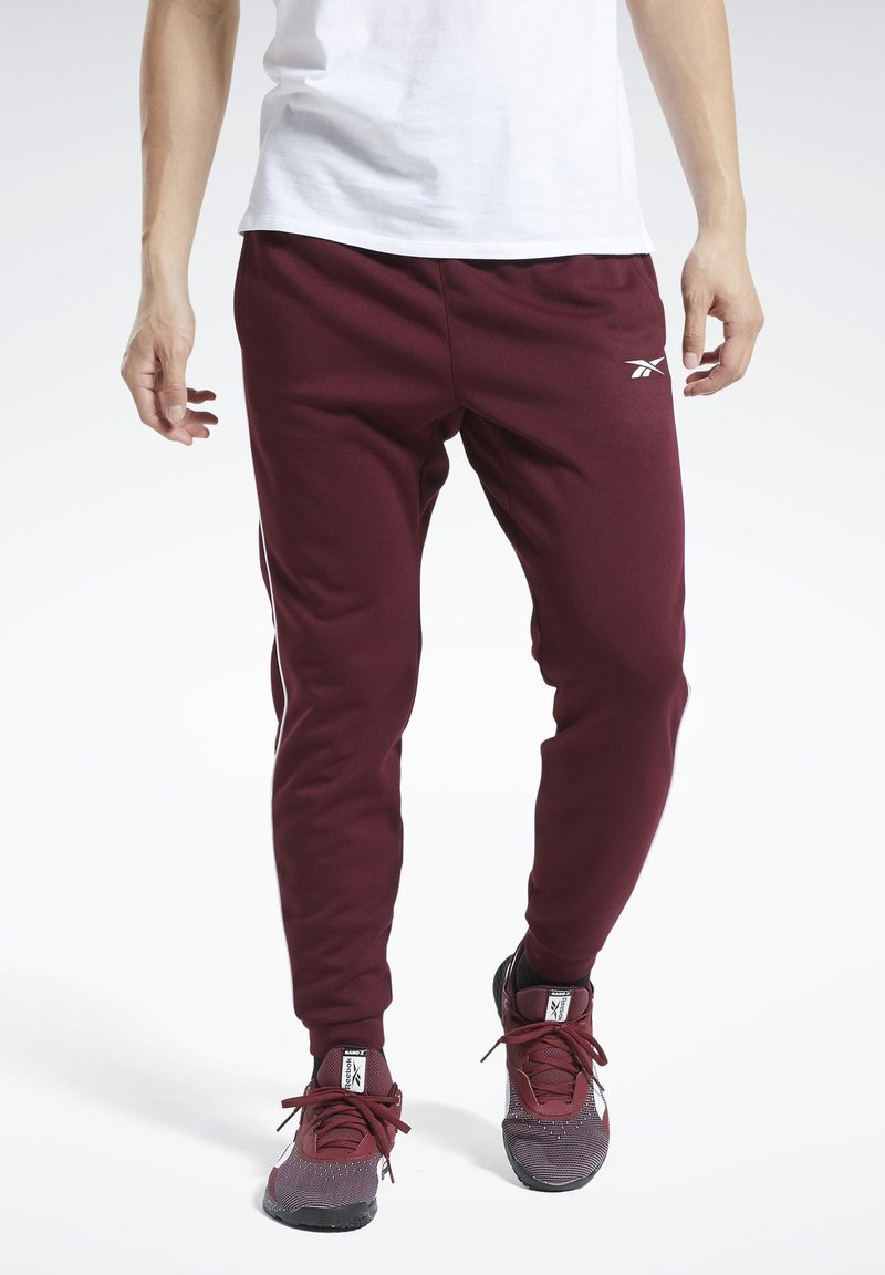 Reebok - WORKOUT READY JOGGERS - Tracksuit bottoms - burgundy