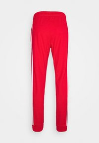 adidas Originals - UNISEX - Pantalon de survêtement - scarle/white - 1