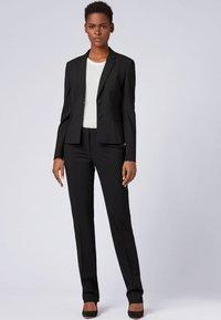 BOSS - TAMEA - Trousers - black - 1