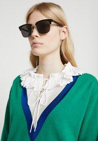 Gucci - Sunglasses - black/gold-coloured/grey - 3