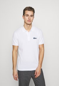 Lacoste - LACOSTE X NATIONAL GEOGRAPHIC - Polo shirt - white/frog - 0
