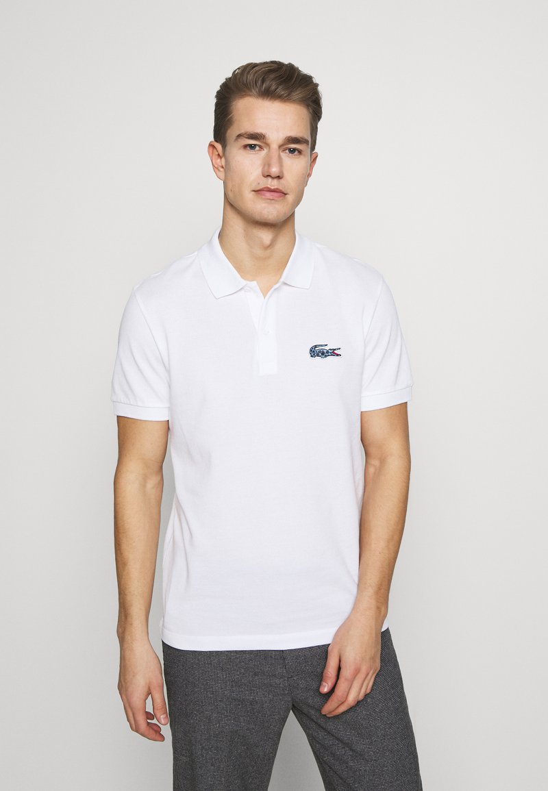 Lacoste - LACOSTE X NATIONAL GEOGRAPHIC - Polo shirt - white/frog
