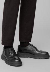 Marc O'Polo - Volnočasové šněrovací boty - black - 0