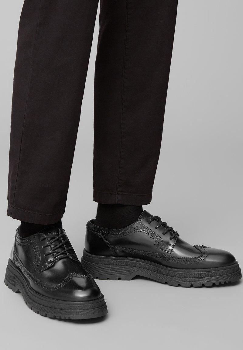 Marc O'Polo - Volnočasové šněrovací boty - black