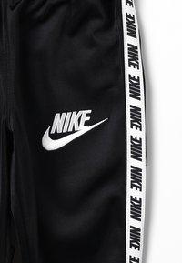 Nike Sportswear - NIKE BLOCK TAPING TRICOT SET - Tracksuit - black - 4