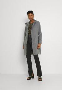 Envii - ENBARBARA SLIT - Straight leg jeans - black - 1