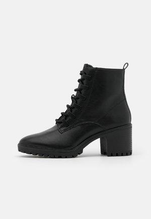 DENIA - Ankle boots - black