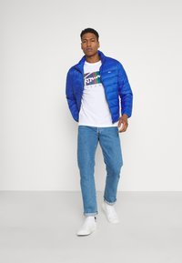 Tommy Jeans - PACKABLE LIGHT JACKET - Down jacket - providence blue - 1
