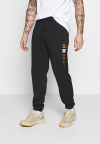 adidas Originals - LOGO - Pantaloni sportivi - black - 0
