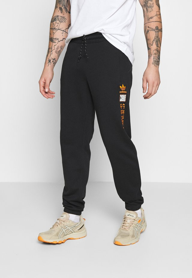 LOGO - Tracksuit bottoms - black