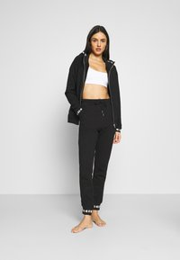 Diesel - UFLB ALINA TROUSERS - Pyjama bottoms - black - 1