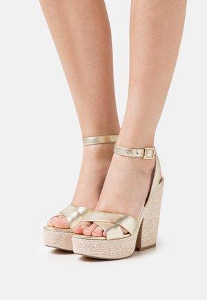 JINA - Platform sandals - gold