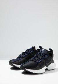 Reebok - SOLE FURY TS - Zapatillas de entrenamiento - black/white - 2