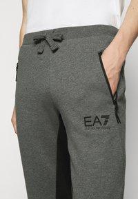 EA7 Emporio Armani - PANTALONI - Tracksuit bottoms - dark grey mel - 4