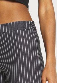 WAL G. - PIN STRIPE SKINNY TROUSERS - Trousers - black/white - 4