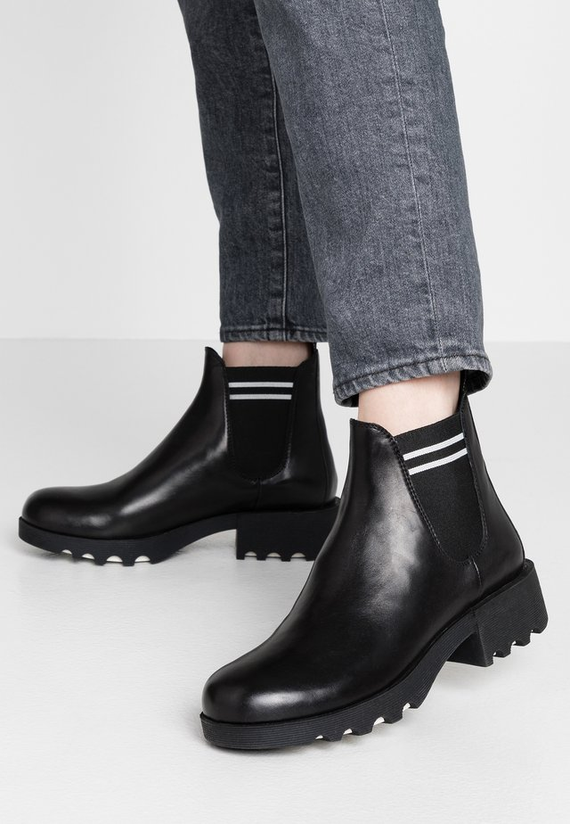 Ankle boots - nero/bianco