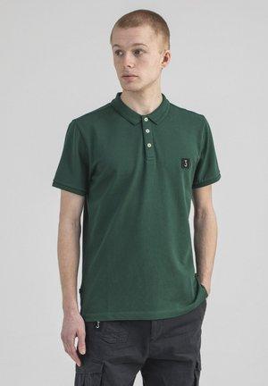COMFORT - Poloshirt - jet green
