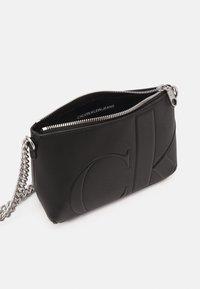 Calvin Klein Jeans - CAMERA POUCH - Taška spříčným popruhem - black - 2