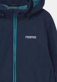 Reima - VESANTO UNISEX - Waterproof jacket - navy - 3