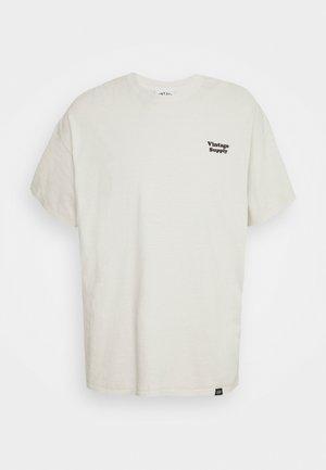 CORE OVERDYE - T-shirt con stampa - beige