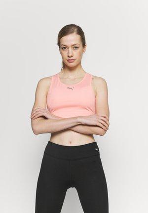 T-shirt sportiva - apricot blush