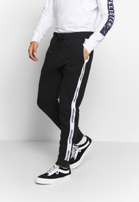 Hollister Co. - Tracksuit bottoms - black - 0