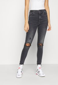 American Eagle - HIGHEST RISE JEGGING - Jeggings - black in the dayz - 2