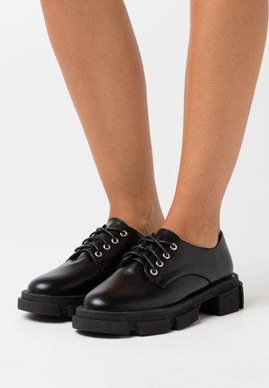 AMARYL - Platform heels - black