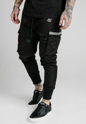 COMBAT TECH PANTS - Cargo trousers - black