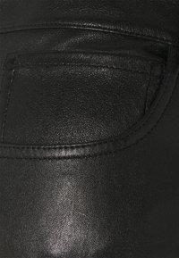 sandro - PAMEL - Leather trousers - noir - 2