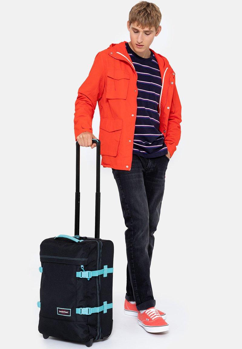 Eastpak - TRANVERZ - Wheeled suitcase - kontrast water