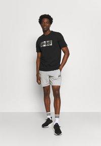 adidas Performance - Sports shorts - medium grey heather/black - 1
