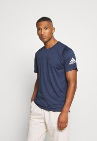 adidas Performance - FREELIFT AEROREADY TRAINING SHORT SLEEVE TEE - Basic T-shirt - mottled dark blue - 0
