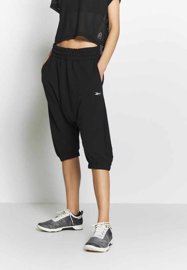 STRIKER PANT - Jogginghose - black